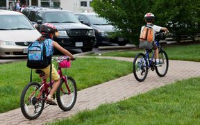 Children cycling on national bike to school day, Arlington, Virginia, US.