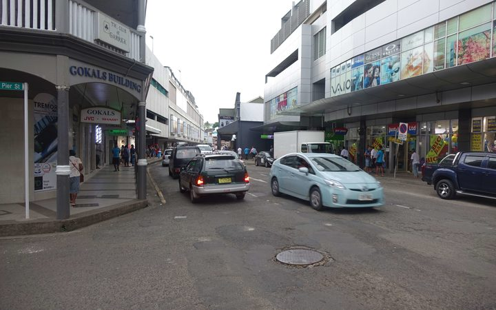 Traffic passes through the central business district of Fiji's capital, Suva.