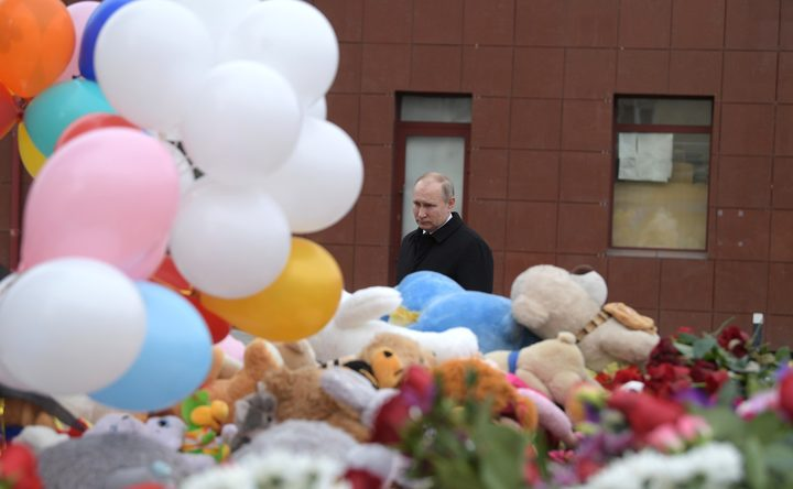 Russian President Vladimir Putin lays a flower at the shopping mall in Kemerovo where over 64 people were killed on March 25, in Kemerovo, Russia on March 27, 2018.