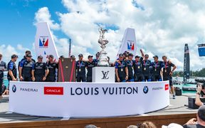 Team New Zealand on stage to be presented with the America's Cup