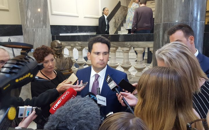 National leader Simon Bridges talks to media in the corridors of Parliament.