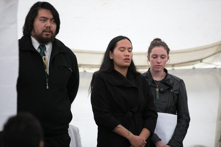 Students of Otorohanga College, (L-R) Zac Henry, Waimarama Anderson and Leah Bell give presentation at the National Commemorations in Russell