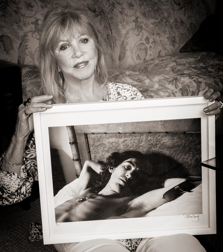 Pattie Boyd with a photo she took of George Harrison