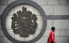 A man walks outside the British embassy building in Moscow