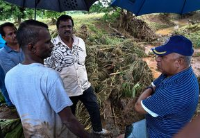 Residents of Yalalevu talk to Fiji Prime Minister Frank Bainimarama following the flood.