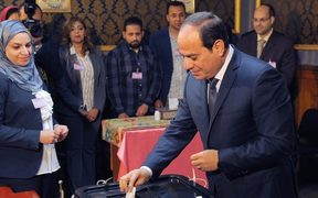 Egyptian President Abdel Fattah al-Sisi casts his ballot during the Egypt's presidential election.