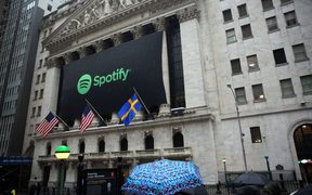 A banner with the Spotify logo on it is seen as the company lists its stock on the New York Stock Exchange in New York, United States on April 3, 2018.