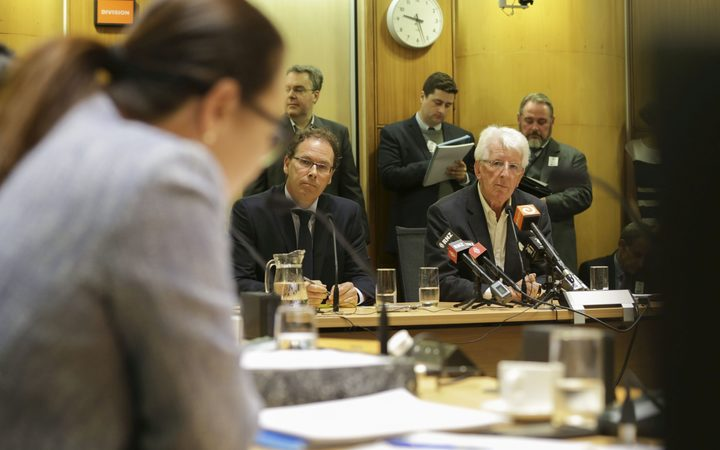 RNZ chief executive Paul Thompson (left) and chair Richard Griffin are grilled at the select committee hearing by National MP Melissa Lee.