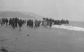 Lifeboat from the Wahine landing passengers and crew on Seatoun beach, 10 April 1968, photographed by an Evening Post staff photographer.