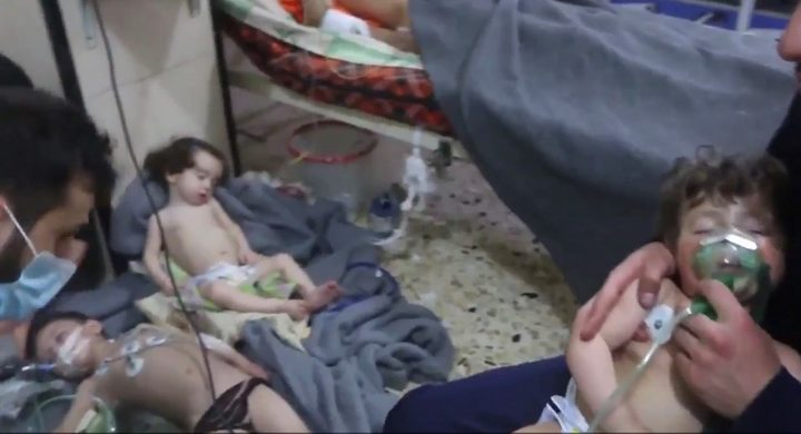 Affected Syrian children receive medical treatment following the apparent chemical attack in Douma.