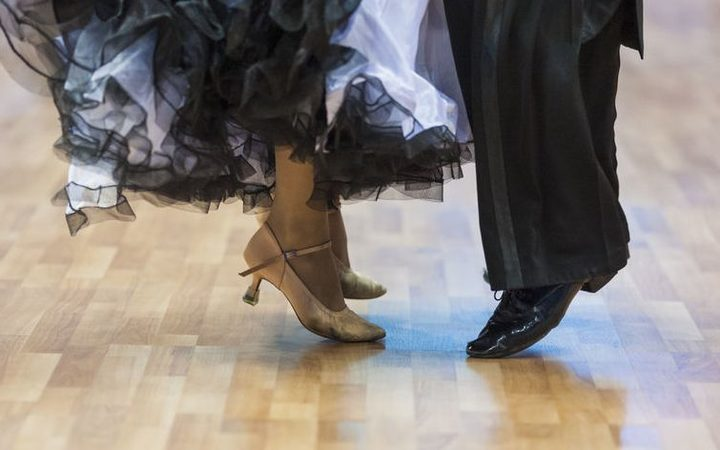 Closeup of legs of the professional dance couple.