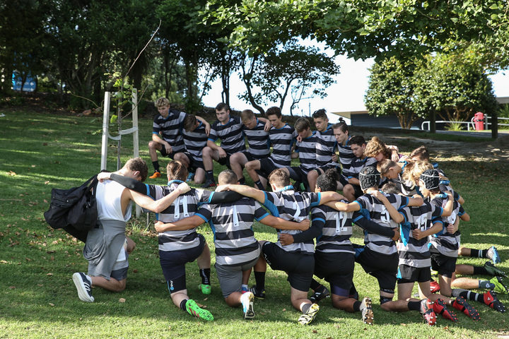 Current Long Bay First XV pay their respects to Peyo.