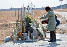 A couple at a shrine near the stricken nuclear plant on the third anniversary of the disaster.