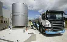 A milk tanker collecting milk from a dairy farm in North Taranaki.