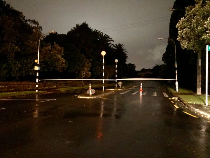 Gillies Ave in Epsom, cut off after a major storm overnight brought down trees and cut power in the area.