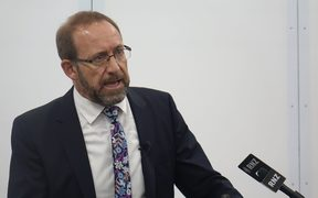 Cabinet MP Andrew Little addressing the public meeting in New Plymouth last night.