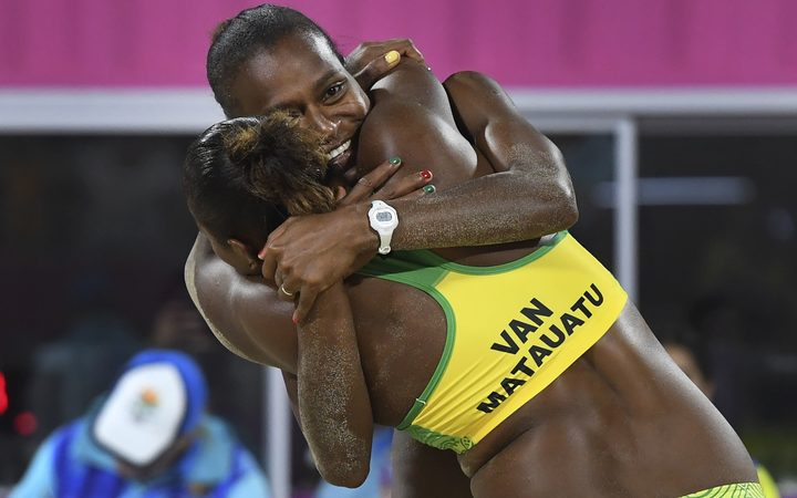 Vanuatu's Miller Pata and Linline Matauatu celebrate winning in the women's beach volleyball bronze medal match against Cyprus