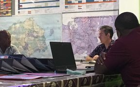 NZ High Commissioner to Fiji Jonathan Curr is briefed by officials from Fiji's Western Division about post cyclone needs, following Cyclone Keni.