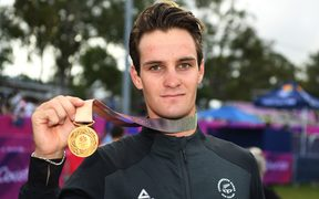 New Zealand's Samuel Gaze with his gold medal for mountain biking.