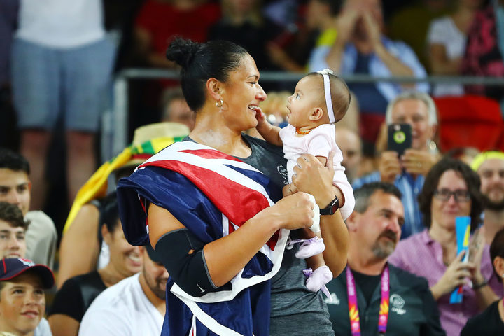 Dame Valerie Adams of New Zealand celebrates with her baby daughter Kimoana Josephine Adams Price