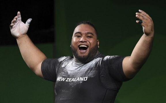 Liti on his way to winning his gold medal in the men's +105kg weightlifting