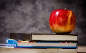 Stock image of school books and apple