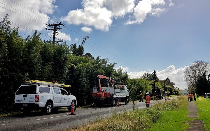 Vector and Treescape crews working on a blacked out Whenuapai Road this morning.