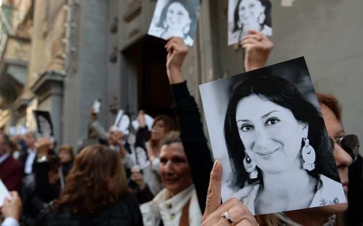 People leave the church of St Francis, after the Archbishop of Malta celebrated mass in memory of murdered journalist Daphne Caruana Galizia on the sixth month anniversary of her death