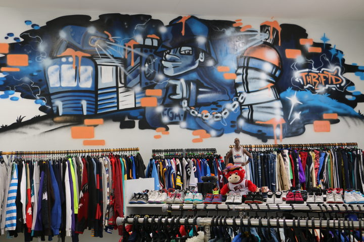 Ra Mead set up Thirft'd Streetwear on a credit card and now business is picking up, and she has steady customer base.