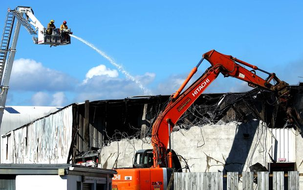 A digger was used to give crews access to the storage units.