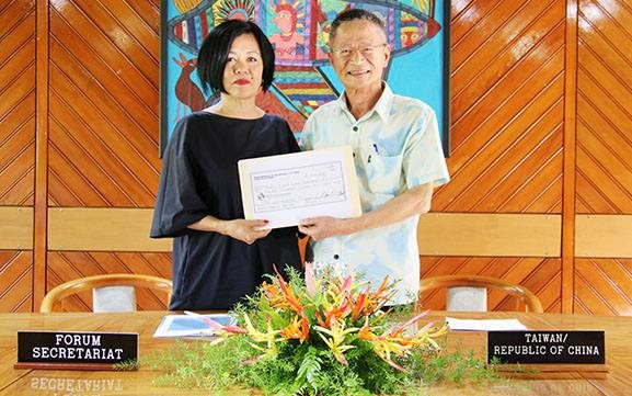 Cristelle Pratt (left) accepts the cheque from Herman Chiu.