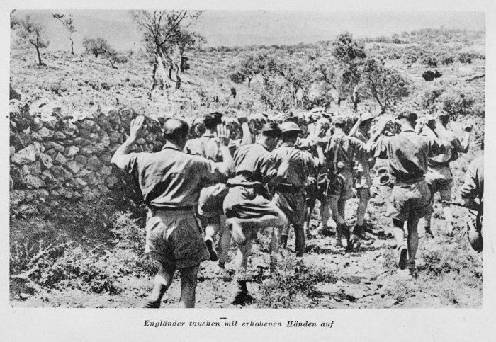 "Allied soldiers being taken prisoner in Greece. The caption reads ""Englishmen appear with hands raised"""