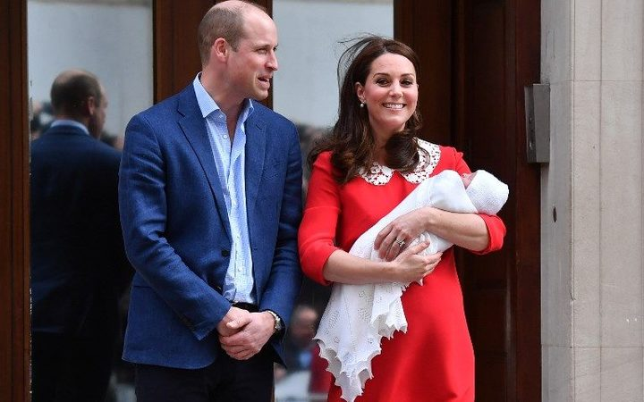 Britain's Prince William, Duke of Cambridge (L) and Britain's Catherine, Duchess of Cambridge show their newly-born son, their third child, to the media outside the Lindo Wing at St Mary's Hospital in central London.
