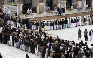 Afghan voters queuing in the Jamee mosque of Herat.