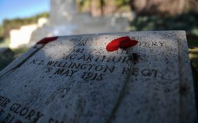 This photo taken on April 24, 2018 shows a dried poppy flower placed on a soldier's gravestone at the ANZAC (Australian and New Zealand Army corps) cemetery in Canakkale on April 24, 2018, on the eve of the 103th anniversary of the ANZAC Day.