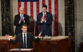 House Speaker Paul Ryan (R) and US Vice President Mike Pence applaud after France's President Emmanuel Macron addressed a joint meeting of Congress.