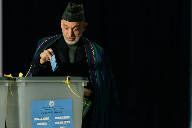Hamid Karzai casts his vote at a Kabul polling station.