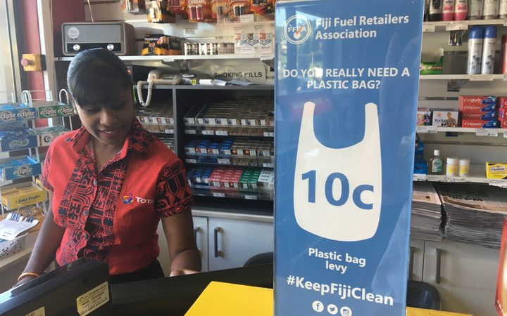 A sign at a petrol station in Fiji discouraging plastic bag use
