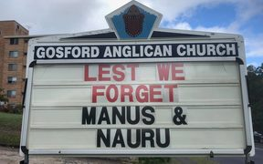 The Anzac day sign outside Gosford church.
