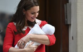 Britain's Catherine, Duchess of Cambridge aka Kate Middleton looks at her newly-born son