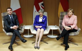 British Prime Minister Theresa May (C), German Chancellor Angela Merkel (R) and French President Emmanuel Macron.