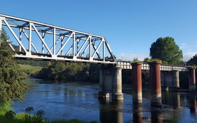 Ngāruawāhia rail bridge, where children jumping off into the water have been hit and killed by trains.