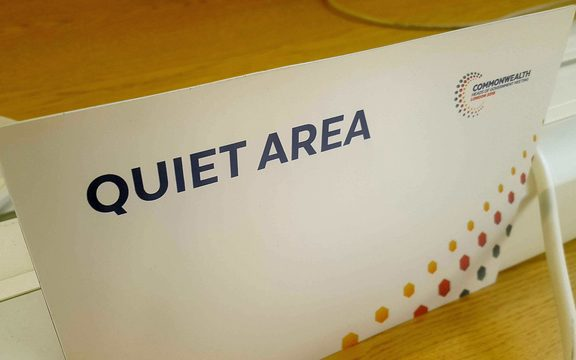 "Sign on table saying ""quiet area"""