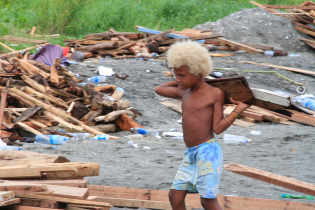 A boy among the rubble left by flooding in the Solomon Islands.