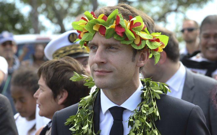 French President Emmanuel Macron takes part in a ceremony on the New Caledonia island of Ouvea. His visit to the island, the scene of a 1988 hostage crisis, was contentious.