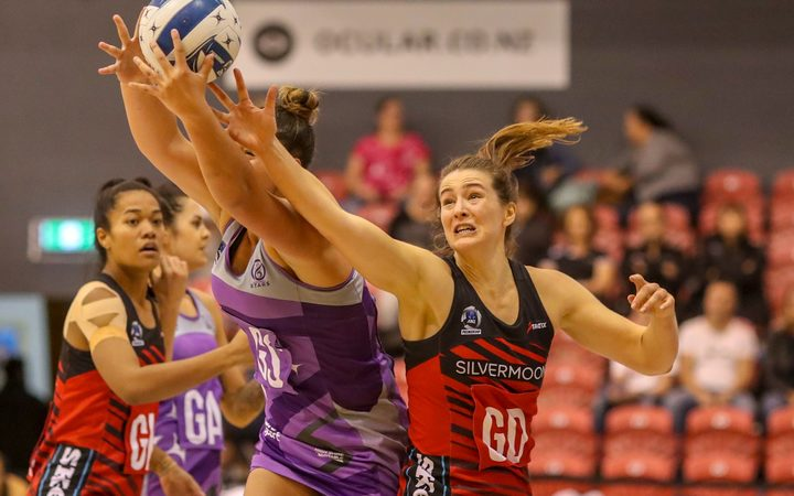 Mainland Tactix captain Jess Mclennan contesting the ball in round one against the Northern Stars