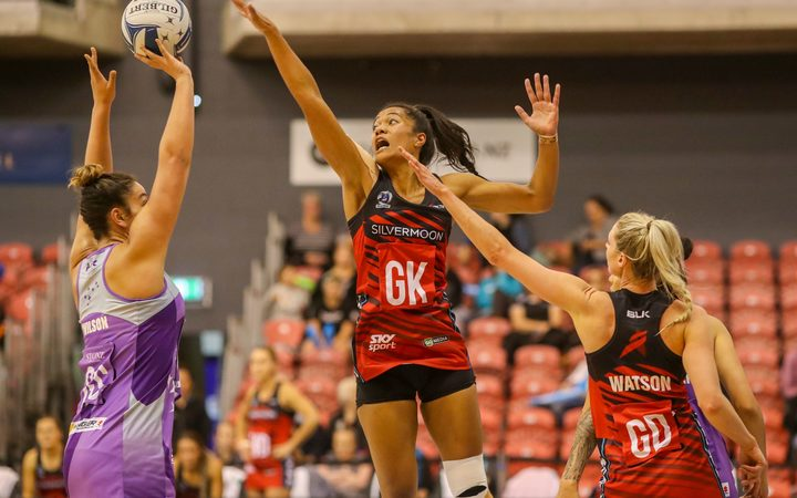 Mainland Tactix goalkeep Temalisi Fakahokotau defending Northern Stars shooter Maia Wilson