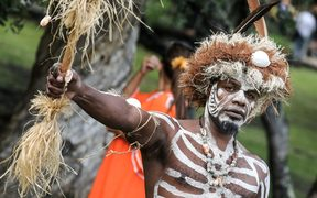 Traditional dancers attend the traditional costume ceremony at the Jean-Marie Tjibaou cultural center with the French president in Noumea, New Caledonia, on May 5, 2018.  / AFP PHOTO / Ludovic MARIN