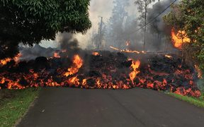A lava flow moves on Makamae Street in Leilani Estates.
