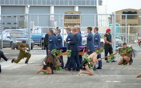 The bodies are welcomed home at the Ōhakea Airforce Base.